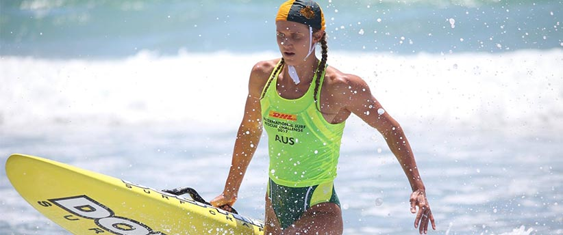 Harriet Brown walking out of surf